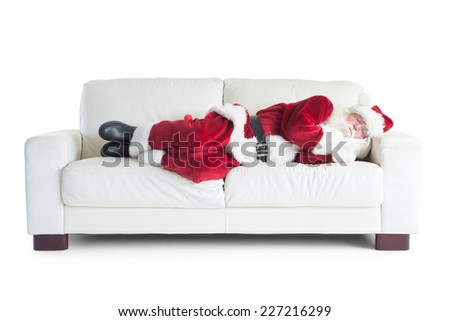 Father Christmas sleeps on a couch on white background - stock photo