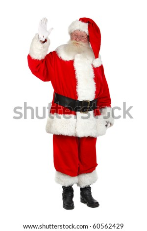 father christmas waving hand and salutes - stock photo