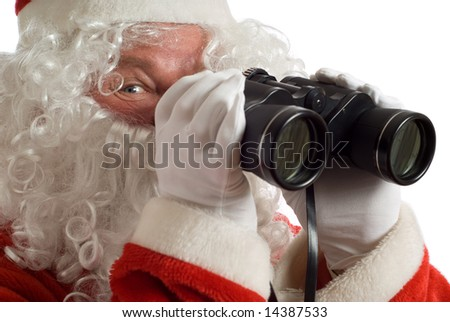 Father Christmas with a jolly look in his eye and binoculars - stock photo