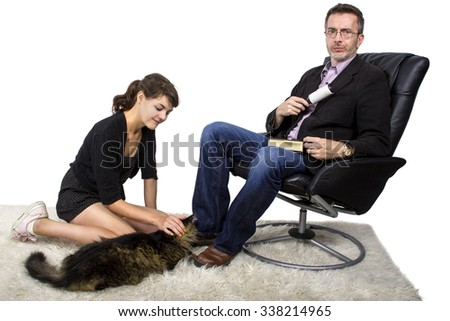 Father cleaning off daughters cat fur and dander off his jacket.  The man is upset about fuzzy cat fur on his clothes.