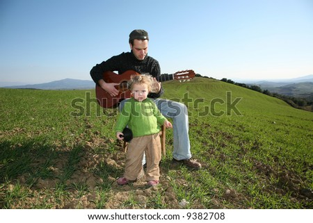 father daughter and guitar