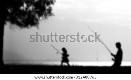 father daughter fishing - picture blurred on purpose using a gaussian blur filter in photoshop