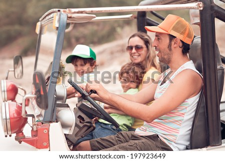 Father driving off-road car - stock photo