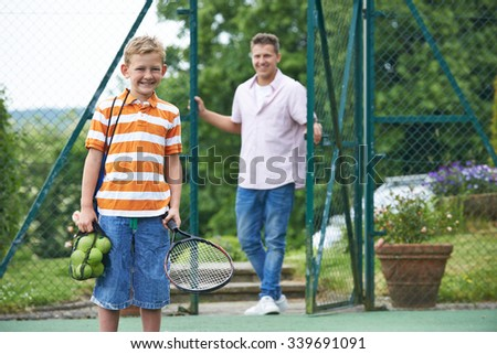 Father Dropping Son Off For Tennis Lesson - stock photo