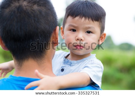 Father embrace with his son - stock photo