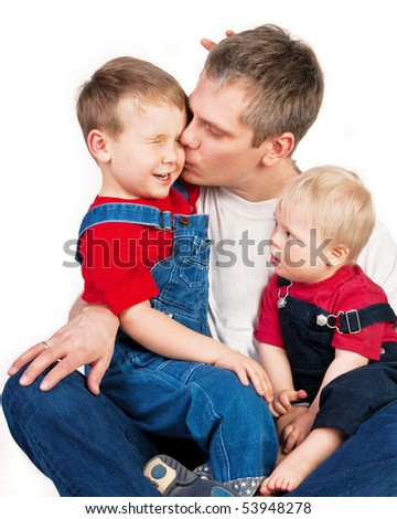 Father embracing competitive children on white background - stock photo
