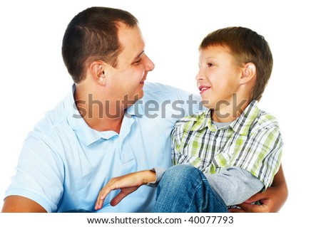 father embracing his son; closeup faces - stock photo