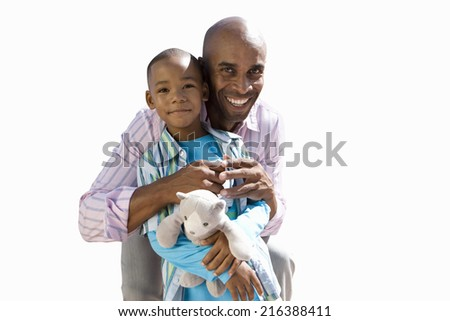 Father embracing son, smiling, portrait, cut out