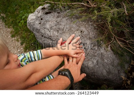 father explaining son about the mountain trail signs - stock photo