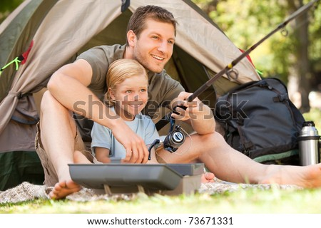 Father fishing with his son - stock photo