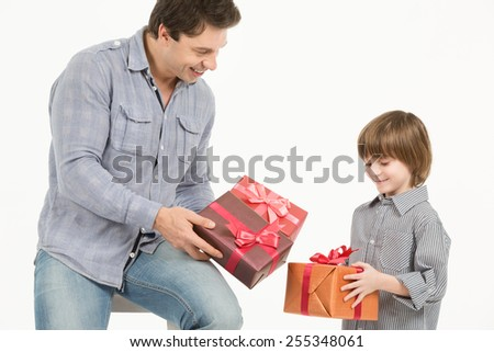 father gives gifts to his son. Isolated on white background - stock photo