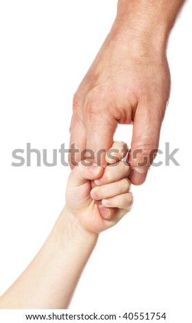 father giving hand to a child; closeup - stock photo