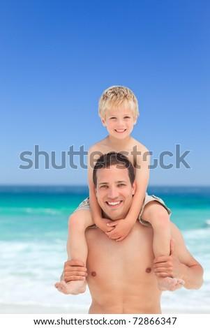 Father giving son a piggyback - stock photo