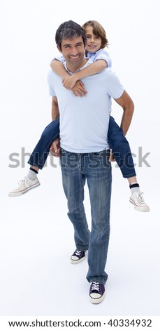 Father giving son piggy back ride against white background - stock photo