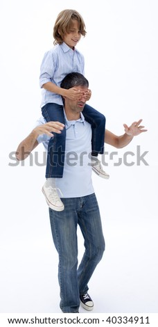 Father giving son piggy back ride with eyes closed against white background - stock photo