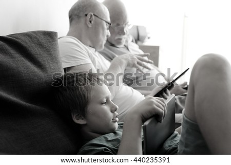 father, grandfather and son - stock photo