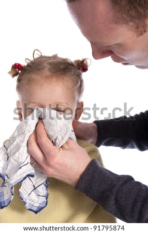 father helping his little girl to blow her nose on white background