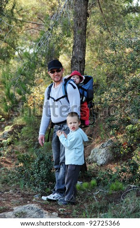 Father hiking with two children - stock photo