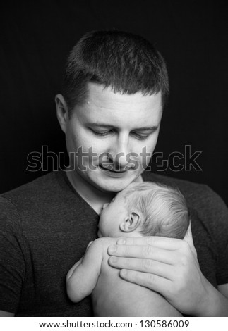 Father holding a newborn baby boy, 11 day old - stock photo