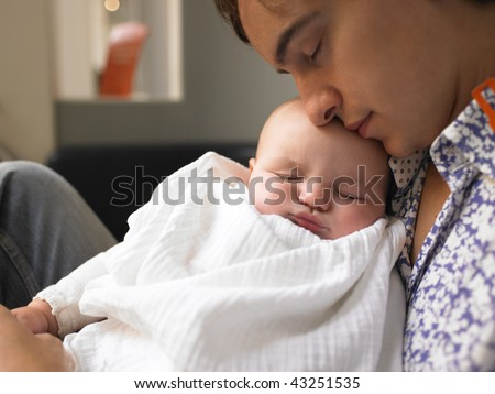 Father holding baby. Both are sleeping. Horizontally framed shot. - stock photo