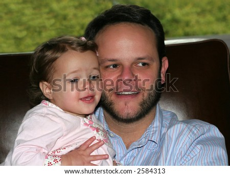 father holding baby daughter - stock photo