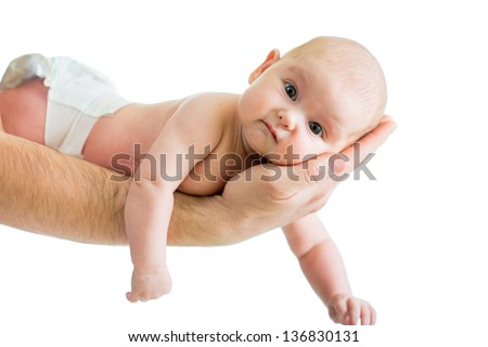 father holding baby in his hand isolated on white - stock photo