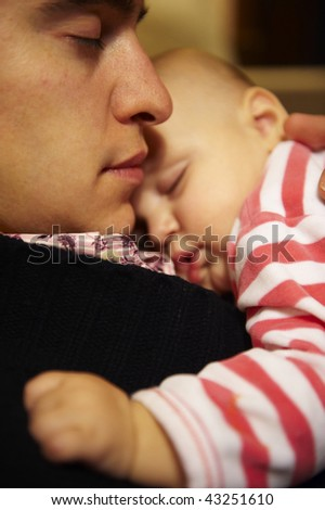 Father holding baby son. They are both asleep. Vertical. - stock photo