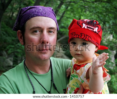 Father holding his baby daughter - stock photo