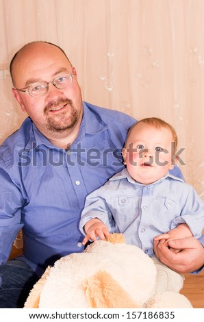 Father holding his son - stock photo