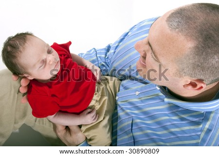 Father holding newborn baby boy in his hands - stock photo