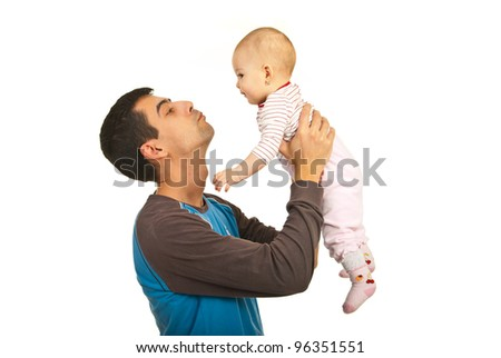 Father holding up his baby girl isolated on white background - stock photo