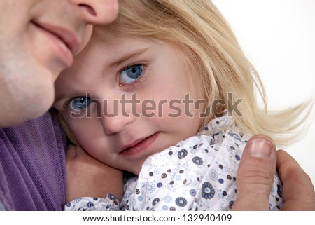 Father holding young daughter - stock photo