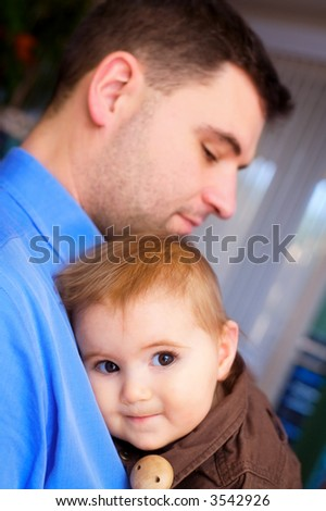 Father holds his a baby girl.