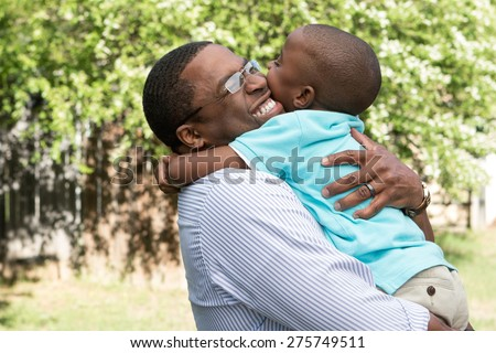 Father hugging her son. - stock photo