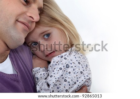 Father hugging little girl - stock photo