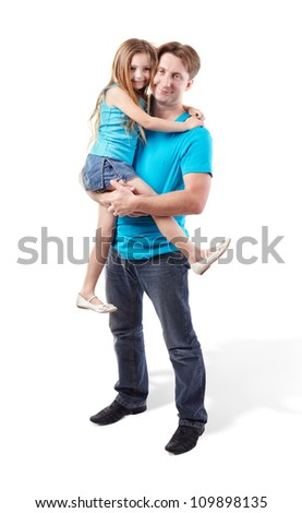 Father in blue shirt holds daughter on his hands - stock photo