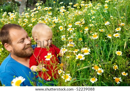 father in his early thirties in the spring meadow - stock photo