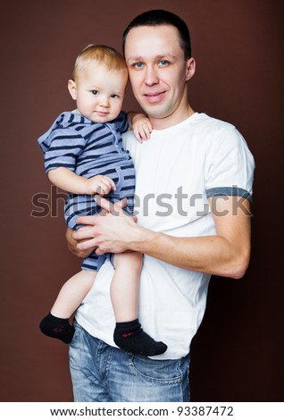 Father is holding baby son