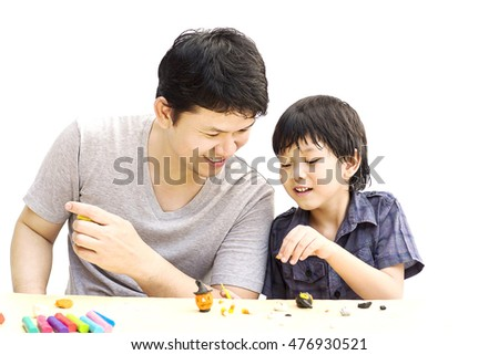 Father is playing Halloween clay with his son over white background