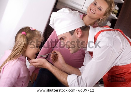 father is preparing lunch for his family - stock photo