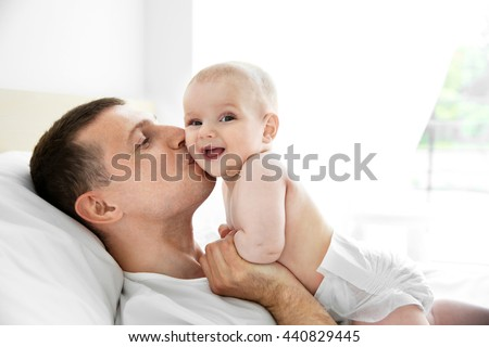 Father kissing adorable baby - stock photo