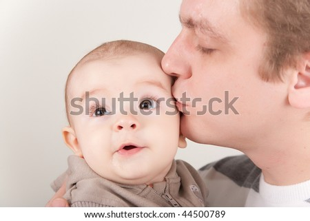 Father kissing his baby