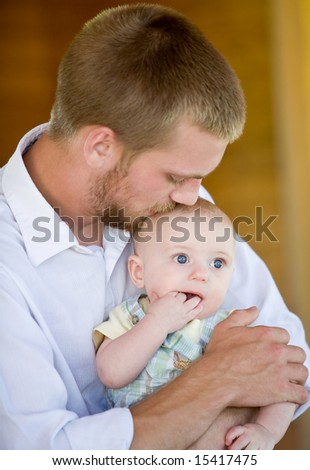 Father Kissing Son - stock photo