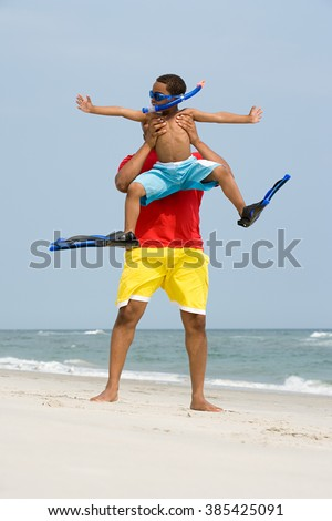 Father lifting son - stock photo