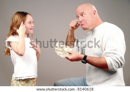 Father Looking Upset as he Gives Daughter Money - stock photo