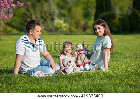 Father, mother and daughter - spending weekend together - stock photo