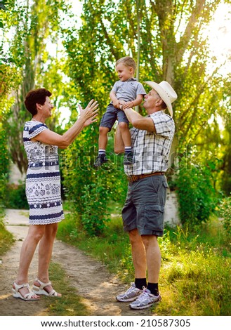 Father, mother and son are playing in nature. Happy family.  - stock photo