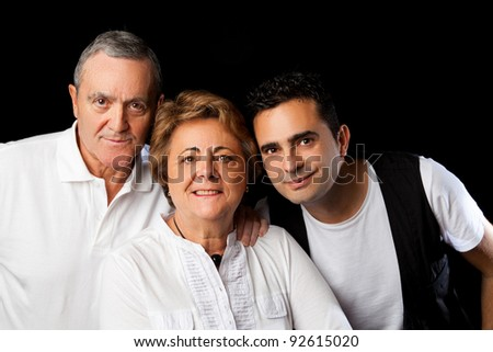 Father, mother and son isolated on black background - stock photo