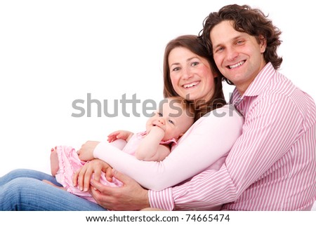 father mother and their baby girl sitting isolated on white background - stock photo