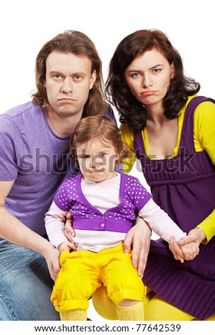Father, mother and their little daughter. All three have a very offended view. - stock photo